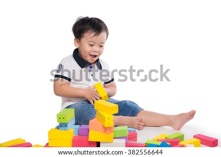 kid playing with building blocks toy isolated on white - stock photo