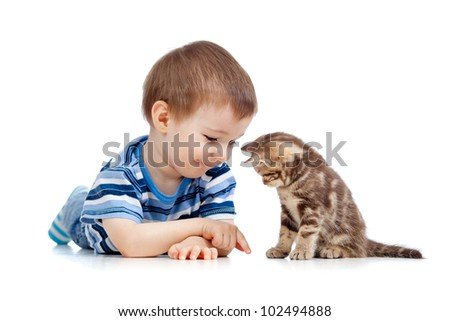 kid playing with cat pet - stock photo