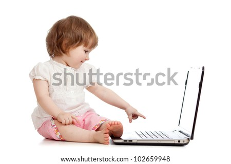 kid pointing by finger to notebook screen on white background - stock photo