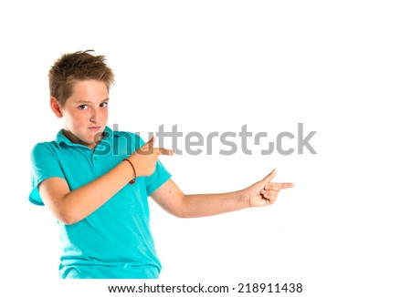 Kid pointing over white background