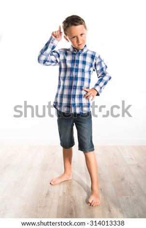Kid pointing to the front - stock photo