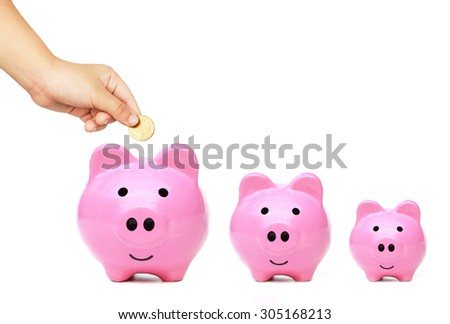 kid putting golden cois into pink piggy banks - Learning to save money concept