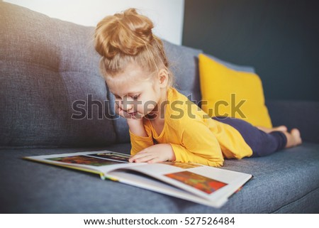 kid reading book at home