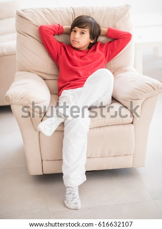 Kid relaxed on sofa