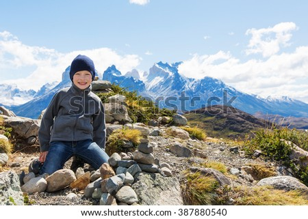 kid resting at mirador condor and enjoying hiking in torres del paine national park, patagonia, chile - stock photo