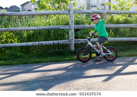 Kid riding his bicycle at the park
