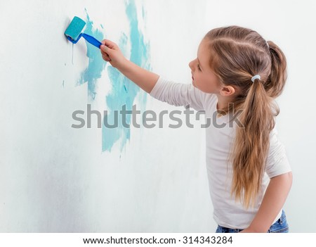 kid rolling wall with new colors - stock photo