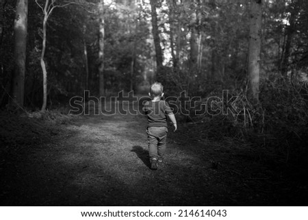 kid running through dark forest