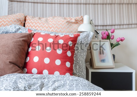 kid's bedroom with colorful pillows on bed at home - stock photo