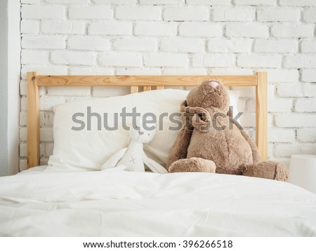 Kid's bedroom with dolls on bed at home - stock photo