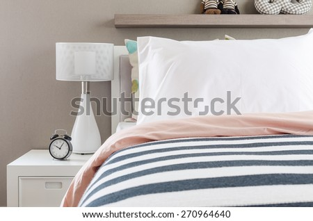 kid's bedroom with white pillows and lamp on modern bed at home - stock photo