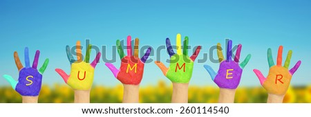 "Kid's painted hands forming word ""summer"".on a background of field of sunflowers and blue sky in sunny day. Summer holidays concept. - stock photo"