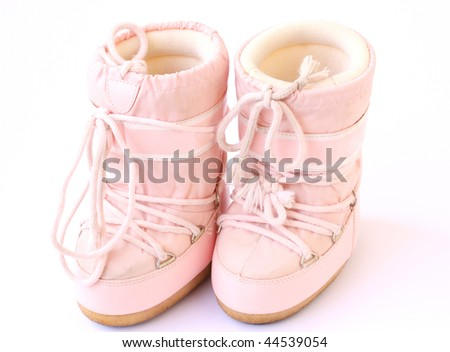kid's pair of snow boots also known as moon boots isolated on a white background - stock photo