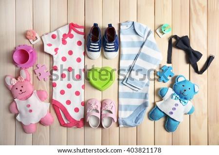 Kid's set on wooden background - stock photo