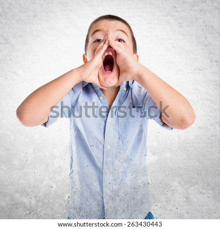 Kid screaming over textured background