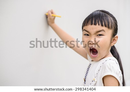 Kid shout and writing on the wall - stock photo