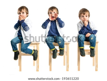 Kid shouting and doing silence gesture over white background - stock photo