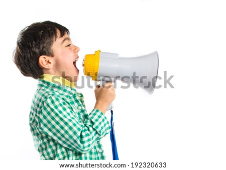 Kid shouting by megaphone over white background