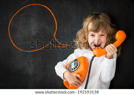 Kid shouting through vintage phone. Business communication concept - stock photo