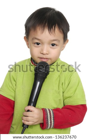 Kid singing, with black microphone ,isolated - stock photo