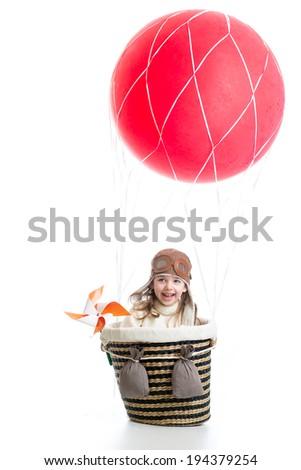 kid sitting inside basket on hot air balloon - stock photo