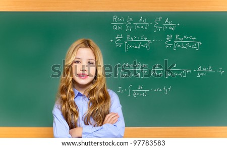 kid smart student girl with difficult math formula on green school blackboard