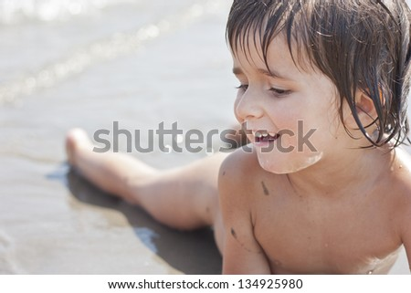 kid smile in the sea - stock photo