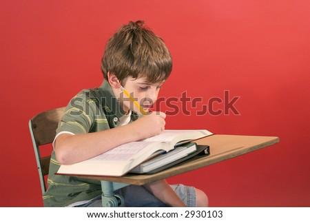 kid studying at desk - stock photo