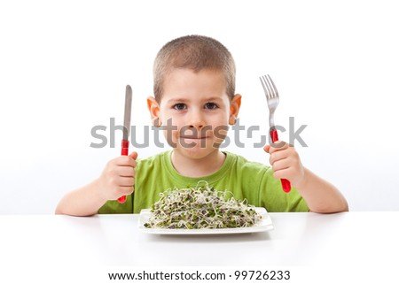 Kid taking green food on white