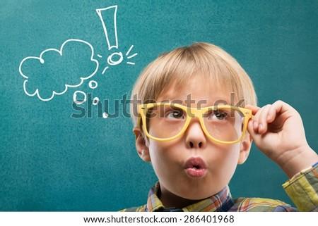 Kid, think, maths. - stock photo