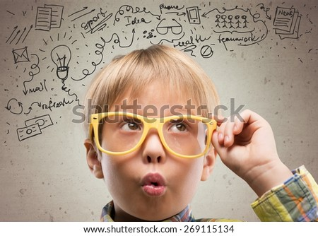Kid. Thinking child with a blackboard in the background - stock photo