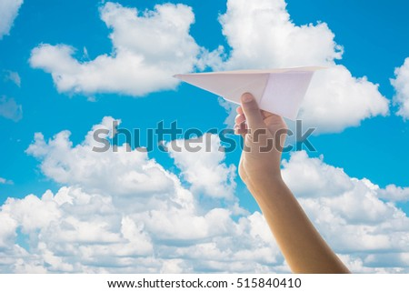 kid throwing playing paper airplane on cloudy sky isolated on cloudy sky with clipping path