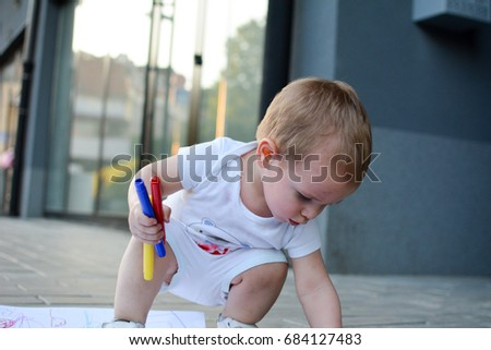 Kid Toddler Baby Boy Playing With Crayons And Plastic Toys Outside Outdoor Photo Child