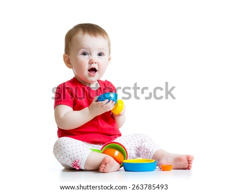 kid toddler playing with color toys isolated on white