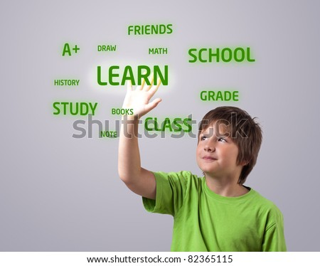 Kid touching LEARN button on a touchscreen - stock photo