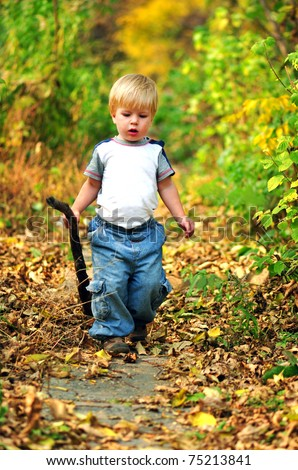 kid walking in the fall park