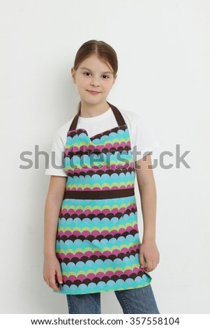 Kid wearing colorful apron - stock photo