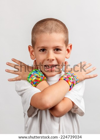 Kid wearing loom band bracelets - stock photo