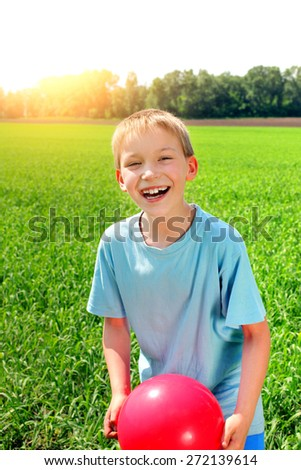 kid with a ball in the summer field - stock photo