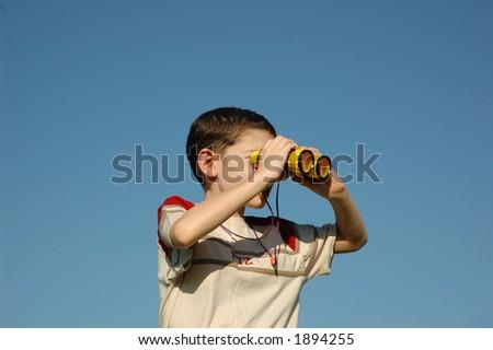 Kid with binoculars - stock photo