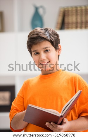 Kid with book at home