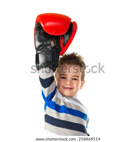 Kid with boxing gloves  - stock photo