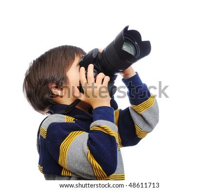 Kid with camera - stock photo