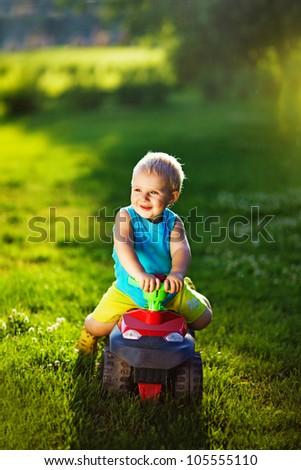 kid with car outdoors