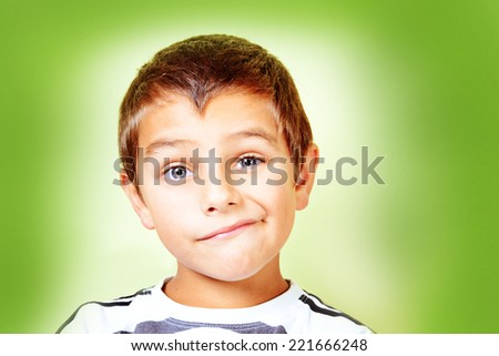 Kid with Dubious face - stock photo