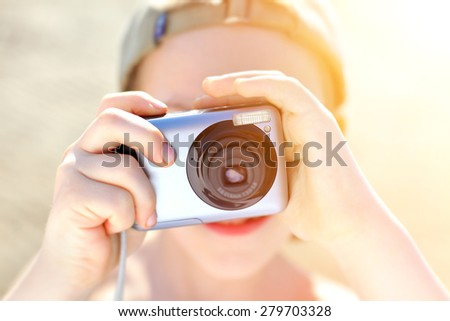 Kid with Photo camera outdoor - stock photo