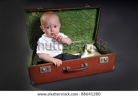 Kid with suitcase - stock photo