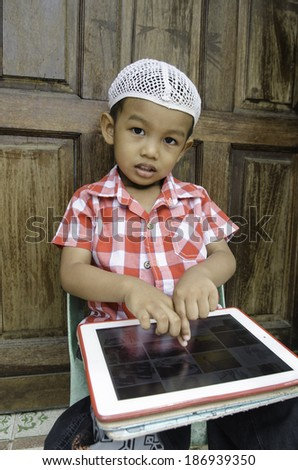 kid with tablet - stock photo