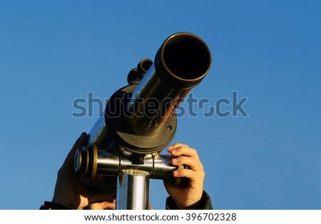 Kid with telescope - stock photo
