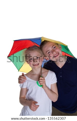 Kid with umbrella with white background; shot in studio